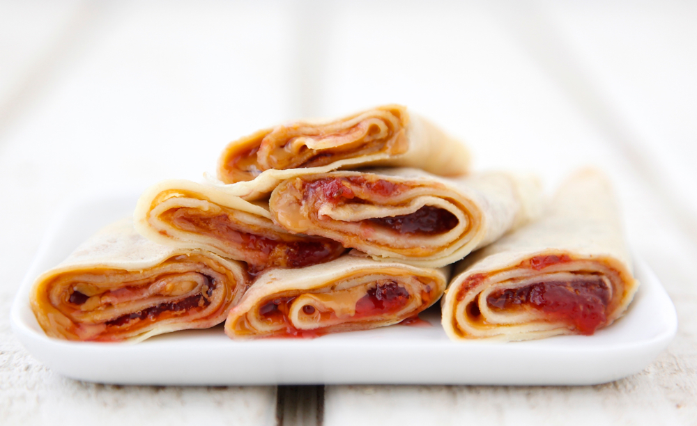 and jam crepe crepes with peanut butter and prepare your crepes roll ...